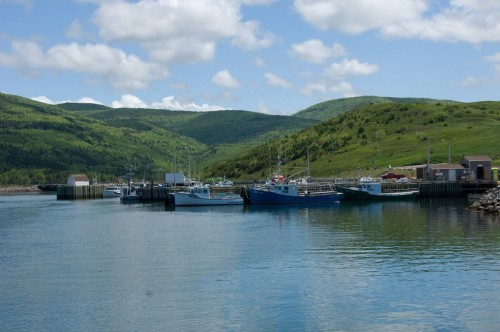 Panoramic views of fishing boats and mountains at the Acadian fishing village of Grand Etang on the Cabot Trail - Credit Photo Nova Scotia Tourism
