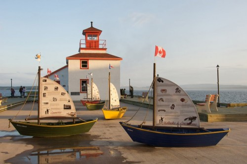 lighthouse replica, surrounded by miniature dories, is a new attraction on the waterfront in the Town of Pictou - Credit Photo Nova Scotia Tourism